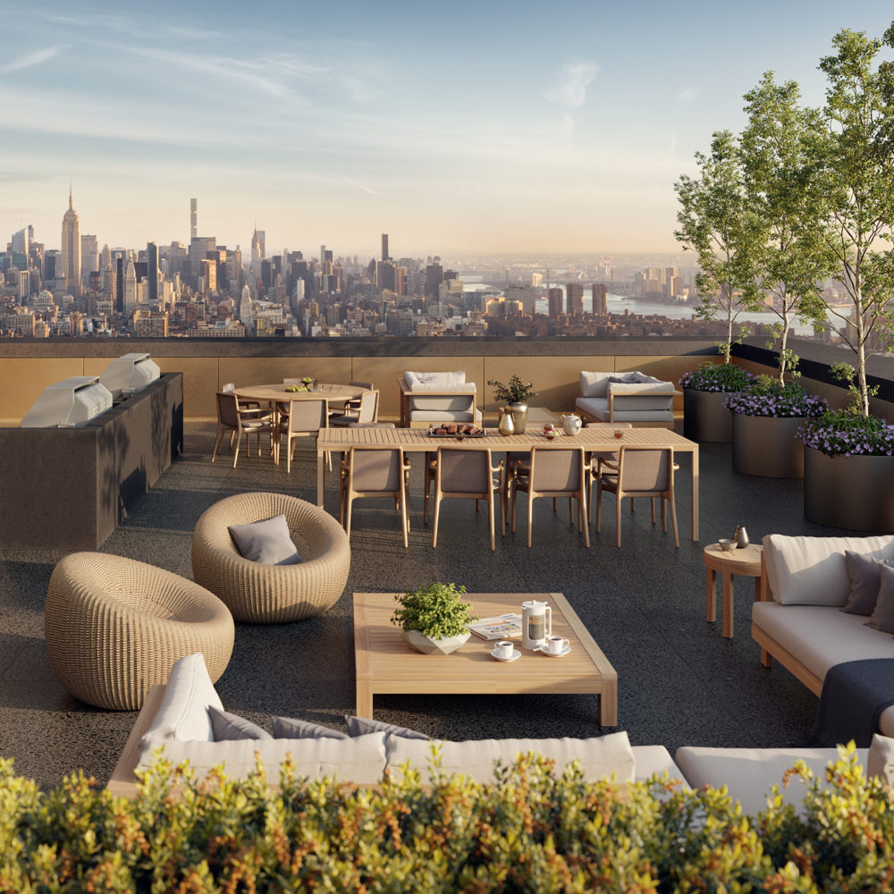 Rooftop patio at 130 Williams condos in New York City. Trees and bushes border the patio with tables, couches and chairs.