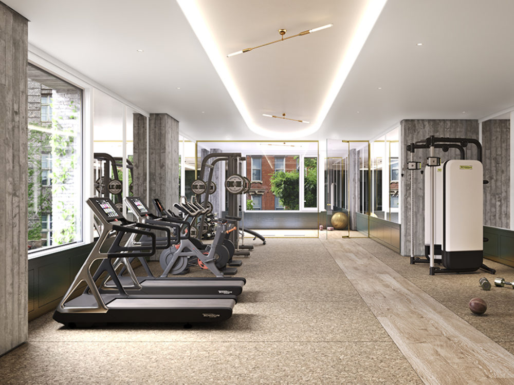 Fitness center of 180 E 88th street condominiums in New York City. Includes cardio and conditioning equipment and windows.