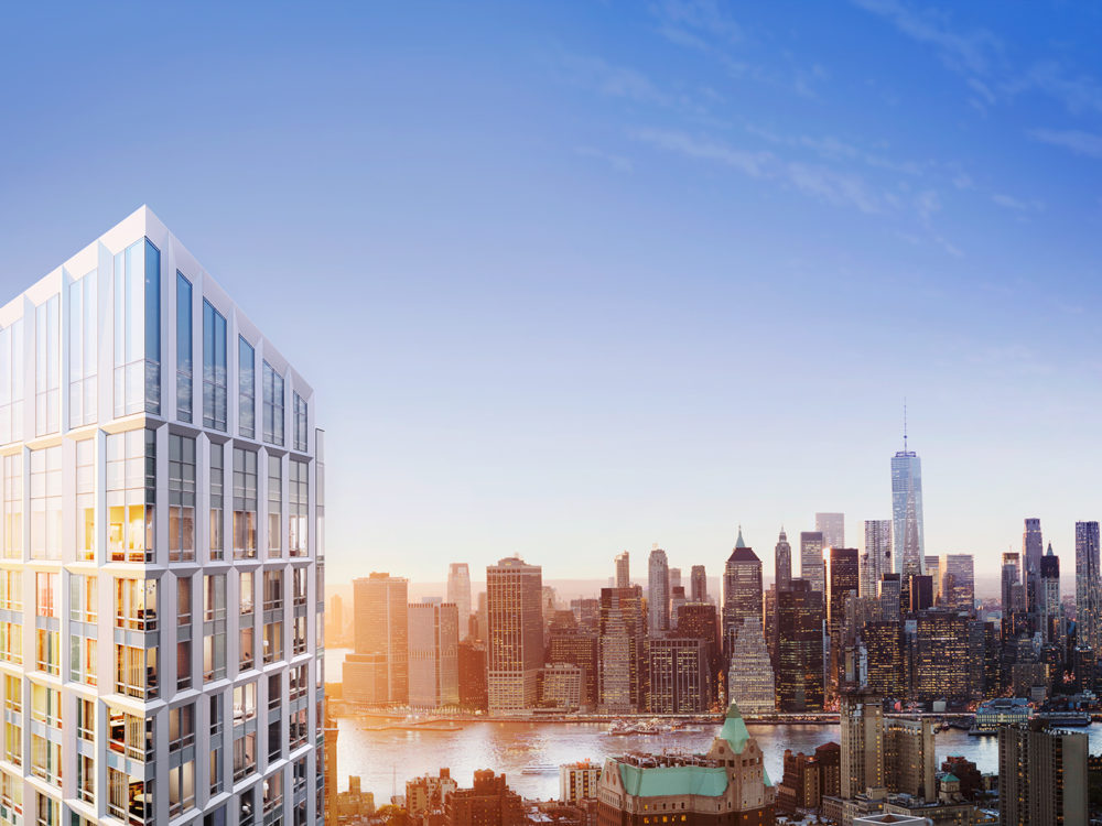Exterior aerial view of Brooklyn Point condominiums with view of Brooklyn, New York buildings in the background.