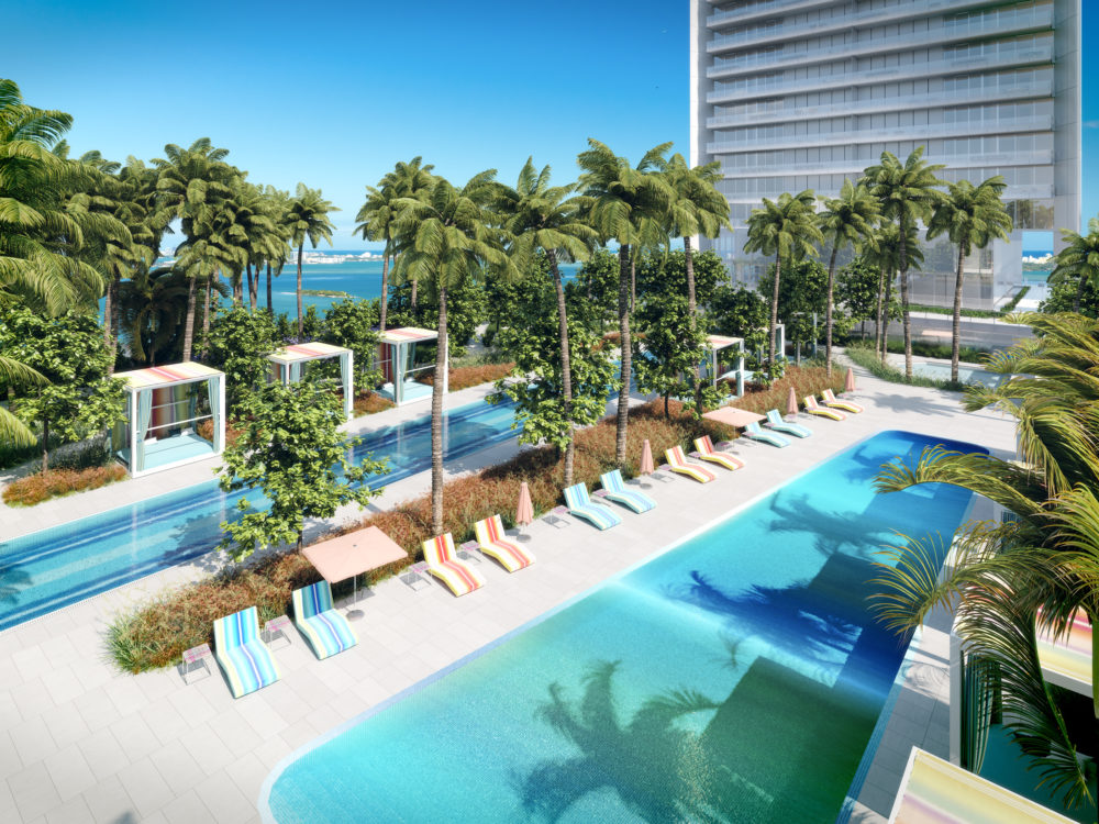 Birds eye view of palm covered pool deck at Missoni Baia luxury condominiums in Miami, FL.