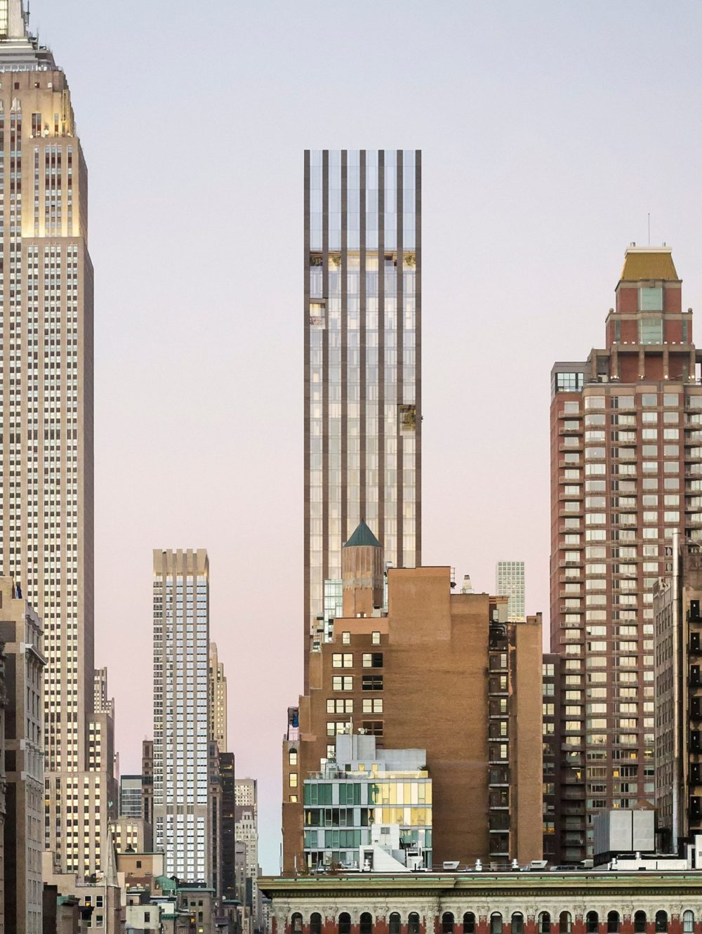 Exterior closeup view of 277 Fifth Avenue condominiums. Includes view of New York City and detailed architectural building.