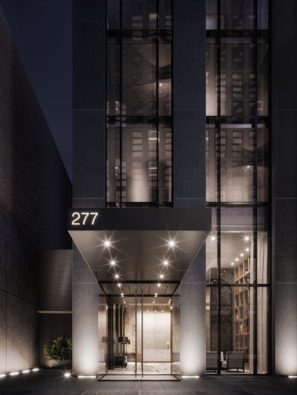 Entry of 277 Fifth Avenue luxury condos in New York. Night time picture with ground lighting, double doors & entrance canopy.