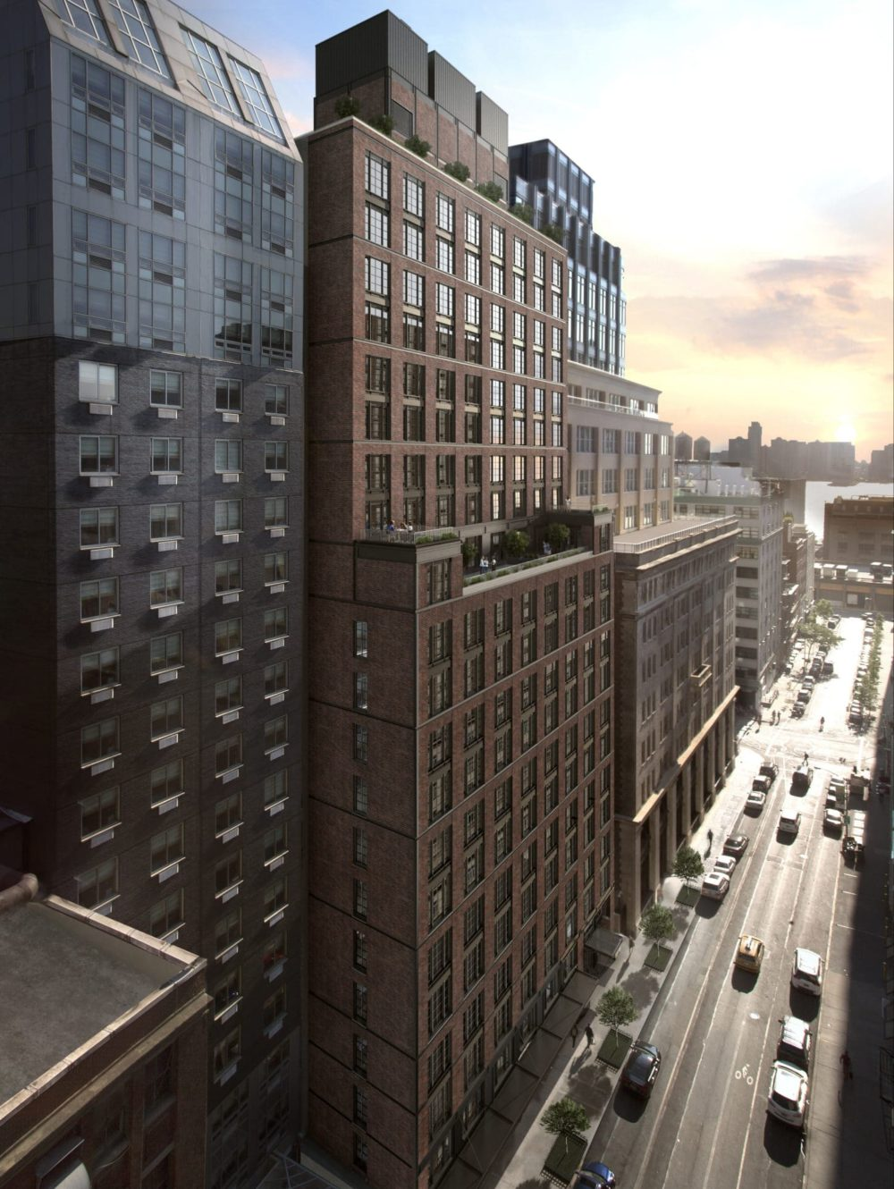 Exterior aerial view of 70 Charlton condominiums with New York City sunset in the background.