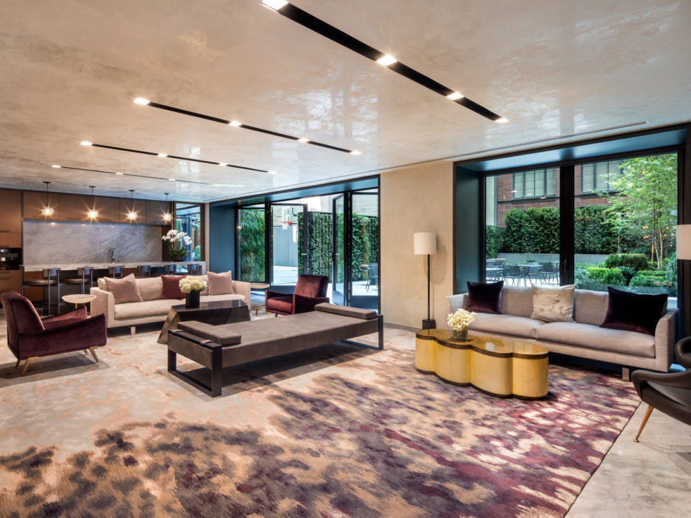 Interior view of 70 Charlton residence lounge in New York City. Has couches, open floor area and windows.