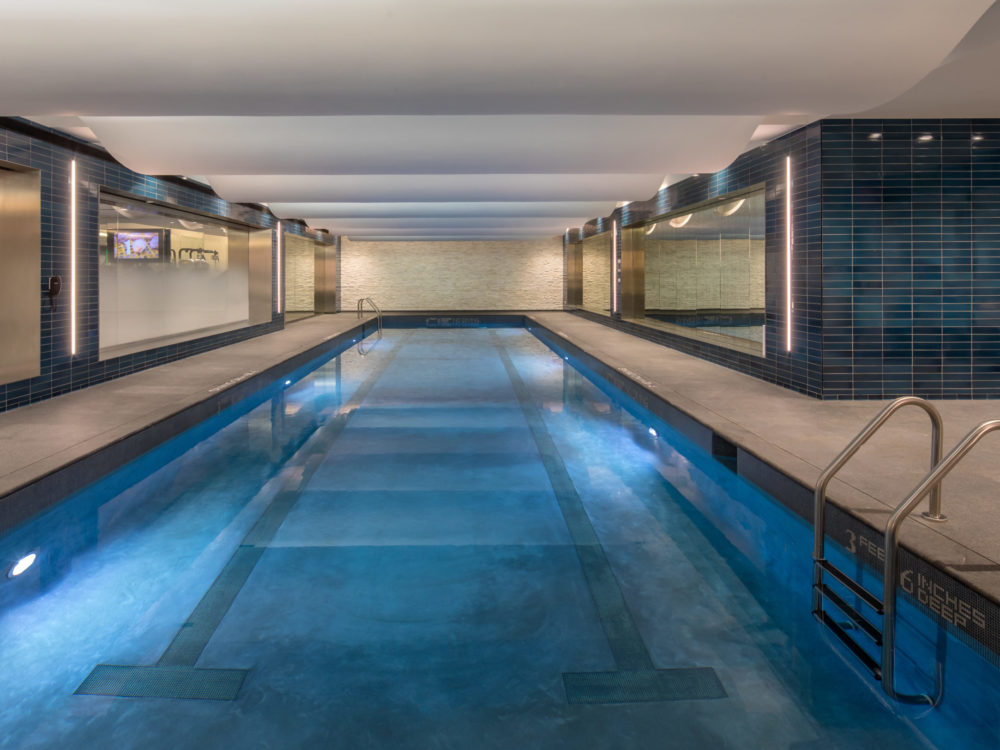 Interior view of 70 Charlton residence indoor pool in New York City. Has rectangular pool and areas to sit.