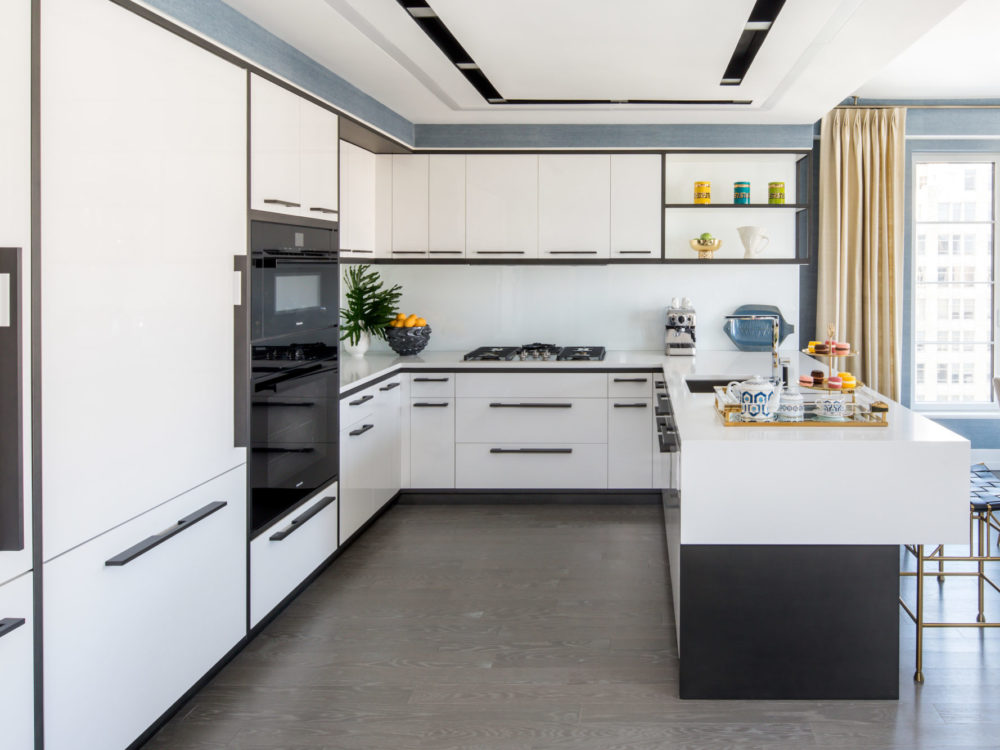 Interior view of 70 Charlton residence kitchen in New York City. Has white cabinets and countertops.