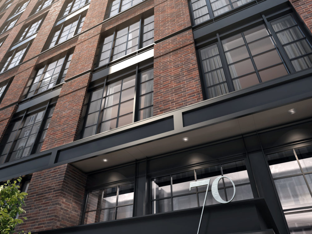 Exterior scale view of 70 Charlton condominiums in New York City. Has brick walls and black window frames.