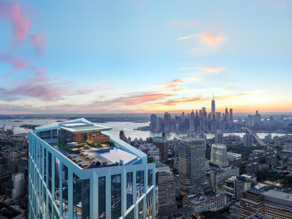 Exterior aerial view of Brooklyn Point condominiums rooftop pool. Has view of Brooklyn, New York in the background.
