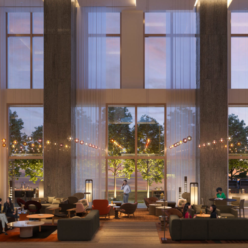 Interior view of Brooklyn Point residence lobby with skyline window view. Has complete lounging sets and light walls.