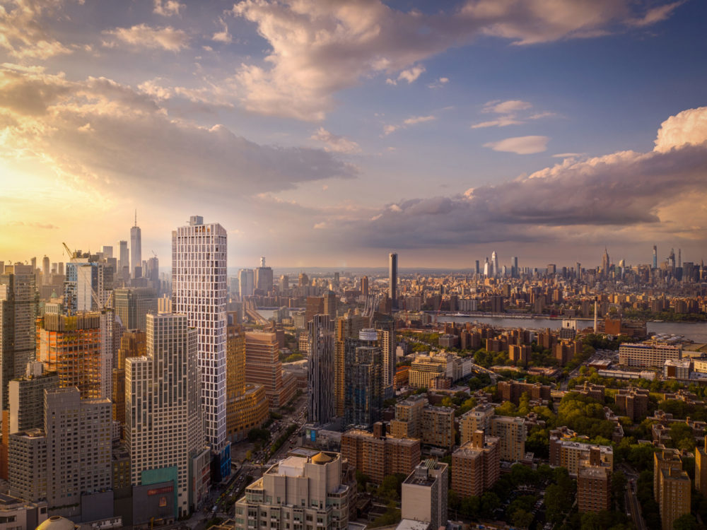 Exterior aerial view of Brooklyn, New York which includes Brooklyn Point condominiums and view of the river.