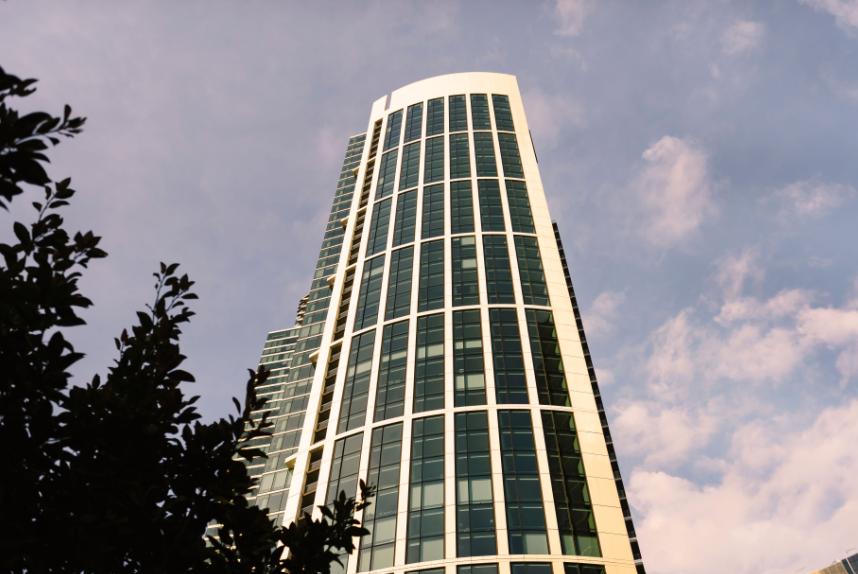 Exterior view of The Harrison in San Francisco. Street level view looking straight up at the residential tower.