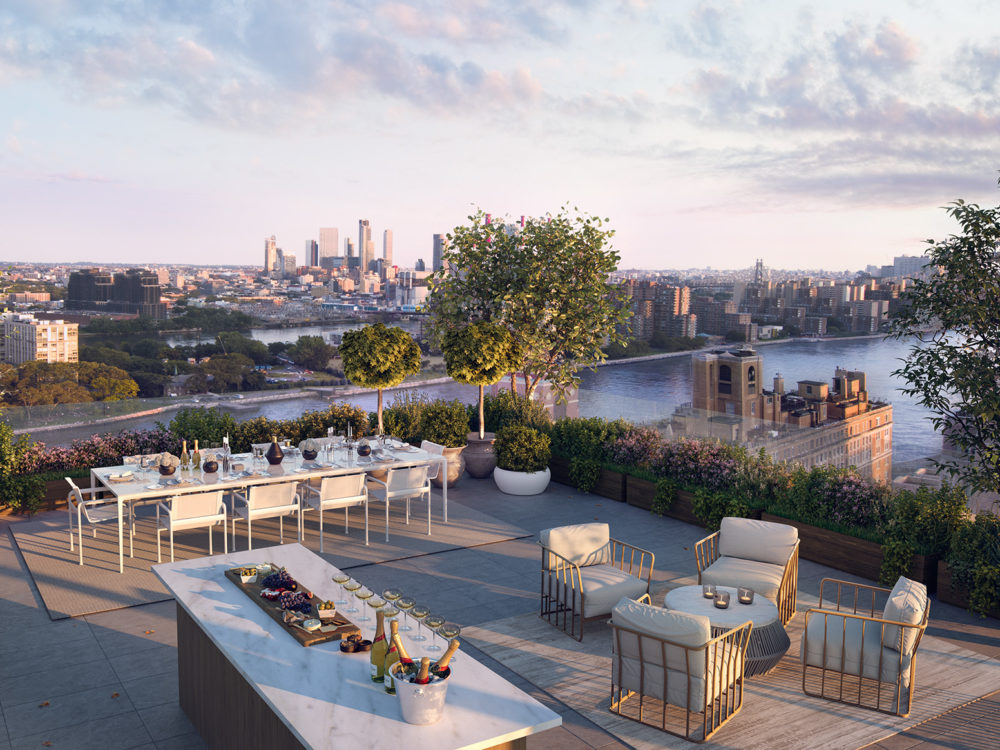Exterior view of 40 East End Ave. condominium rooftop terrace with view of NYC. Includes view of the river, table and chairs.