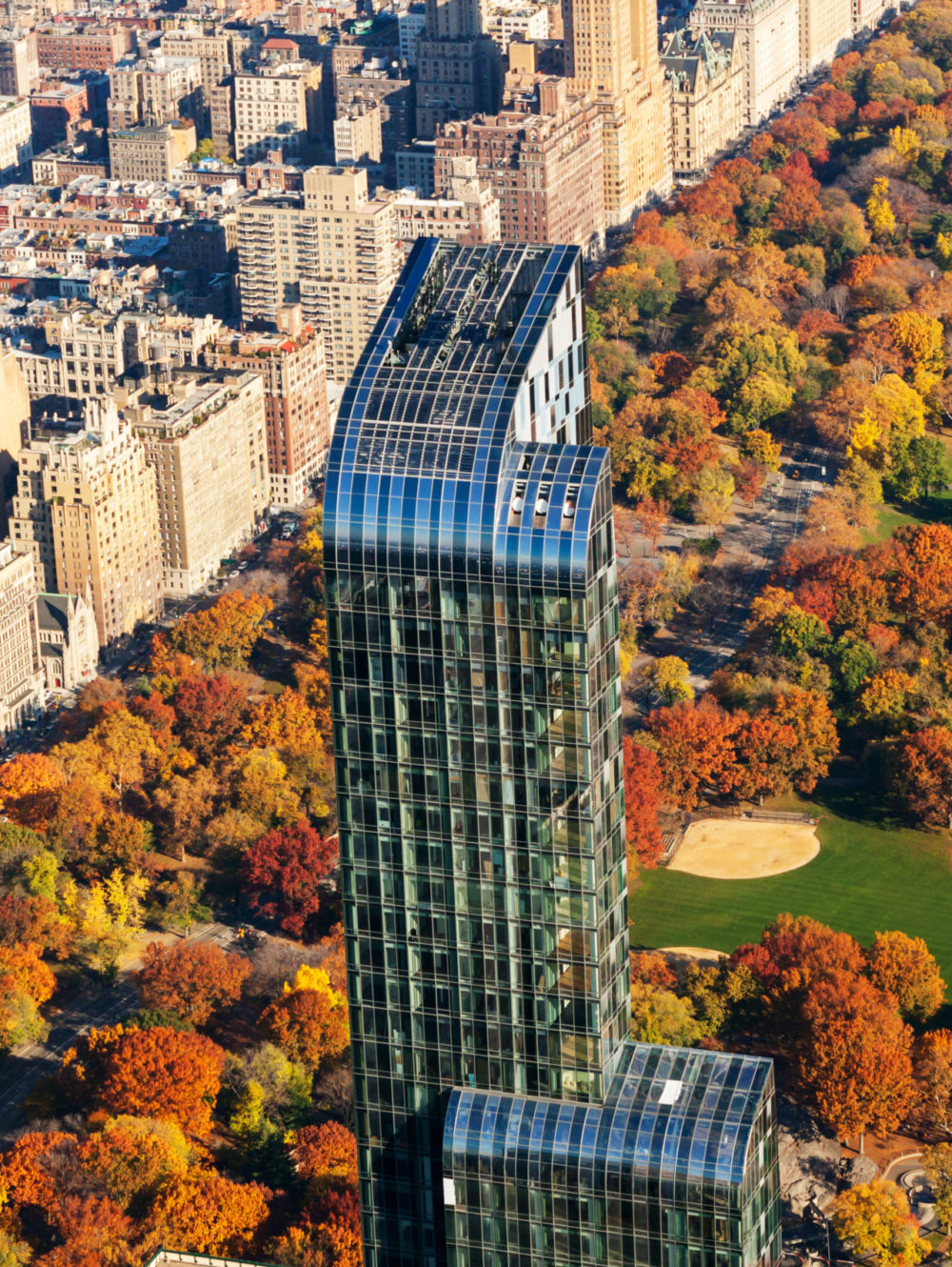 Day time aerial view of One Manhattan Square luxury condos in New York. Background of Central Park and city skyline.
