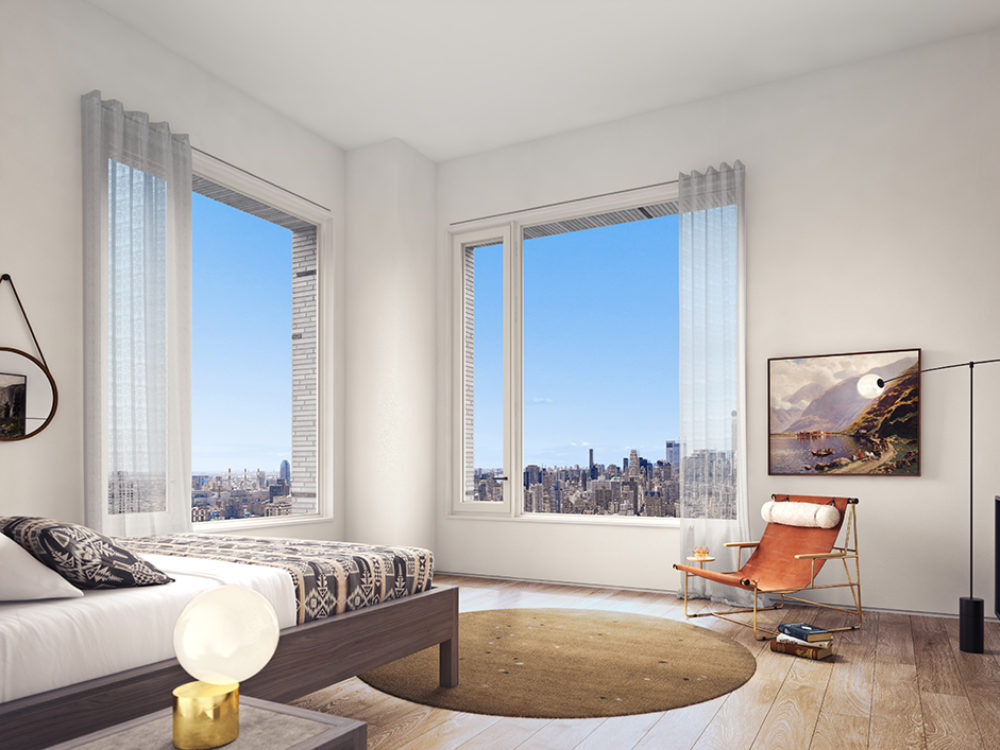 Interior view of 180 E 88th street residential master bedroom. Has window overlooking New York City and a bed with sheets.