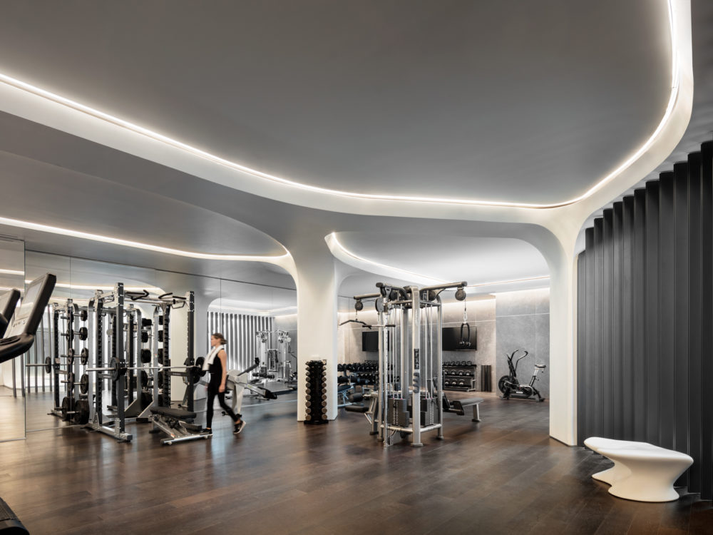 520 W 28 residence interior fitness center view in New York City. Has wooden floor, weightlifting and conditioning equipment.