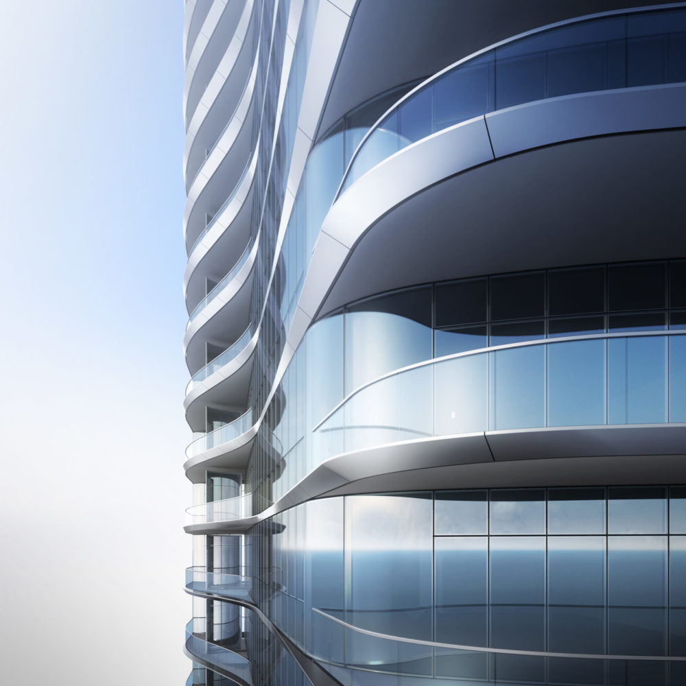 Exterior view of condo balconies at Una Residences in Miami. Metal sided balcony with glass railings and glass walls.