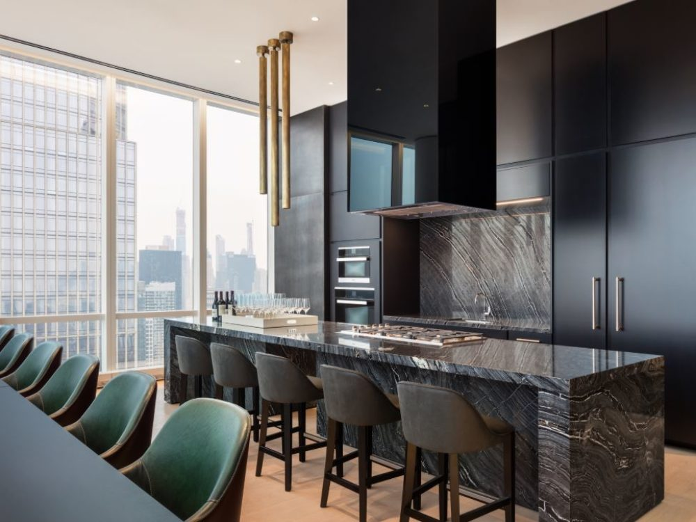 View of conference room inside 15 Hudson Yards with a window view of New York City. Includes a countertop sitting area.