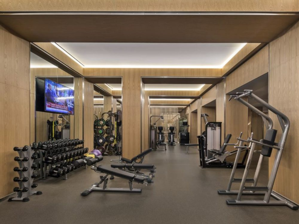 Interior view of 70 Vestry residence fitness center in New York City. Has free weights and cardio equipment.
