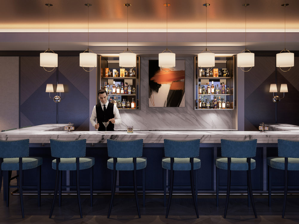 The Club Bar at Four Seasons 706 Mission private residences in SF. Bartender standing behind marble bar top making a drink.