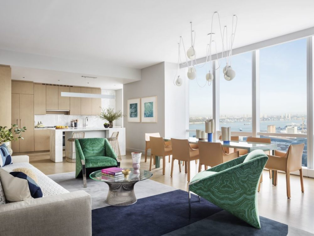 View of 15 Hudson Yards living room, dining room, and kitchen with a window view of New York City.