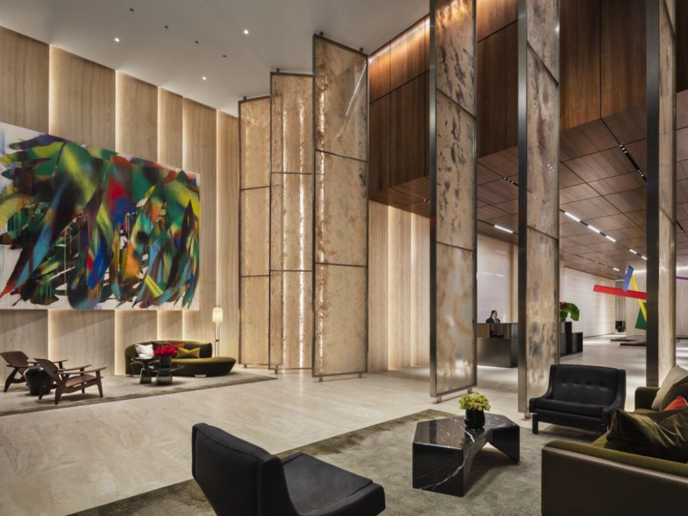 Interior view of 15 Hudson Yards condominium lobby in New York City. Includes a large art mural and tile flooring.