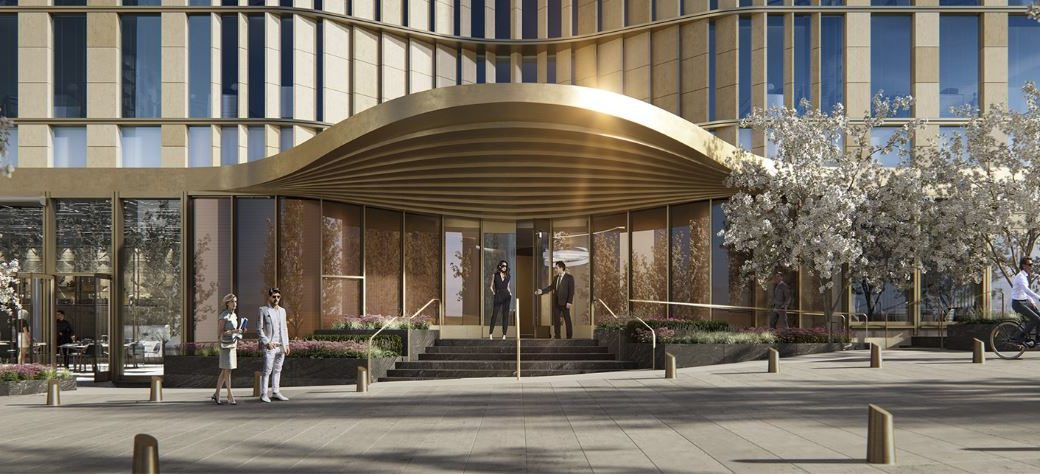 Exterior view of entrance to 35 Hudson Yards located in NYC. Includes night view with white trees and an illuminating side.