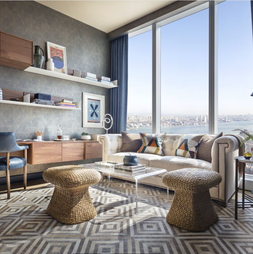 View of 15 Hudson Yards residence study room with window view of New York City. Includes a desk and couches to sit.