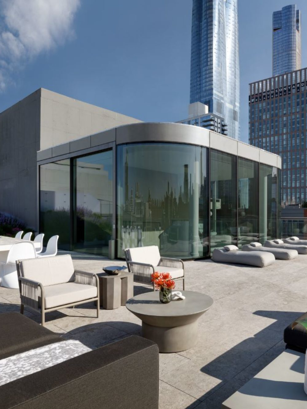 520 W 28 condominium exterior picture of rooftop terrace with a view of New York City. Has tables and couches.