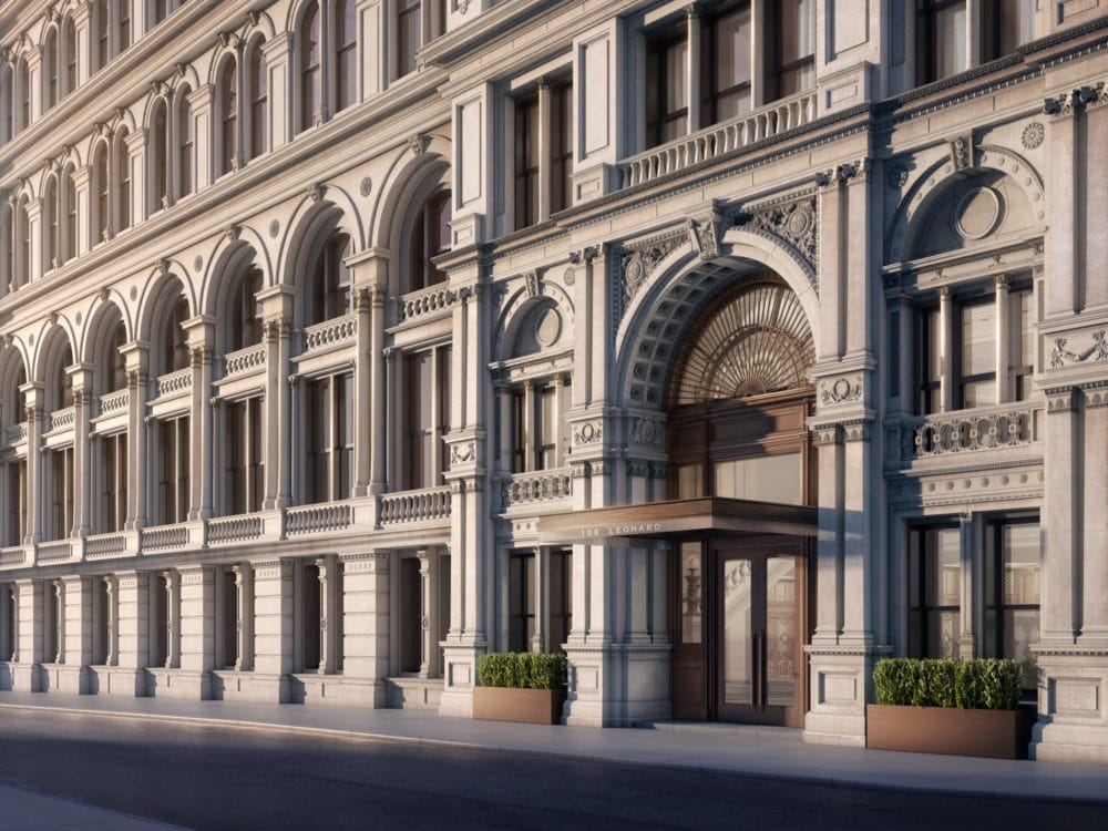 Modern renaissance grand entrance to 108 Leonard condominiums New York City with a meticulously restored mimic head.