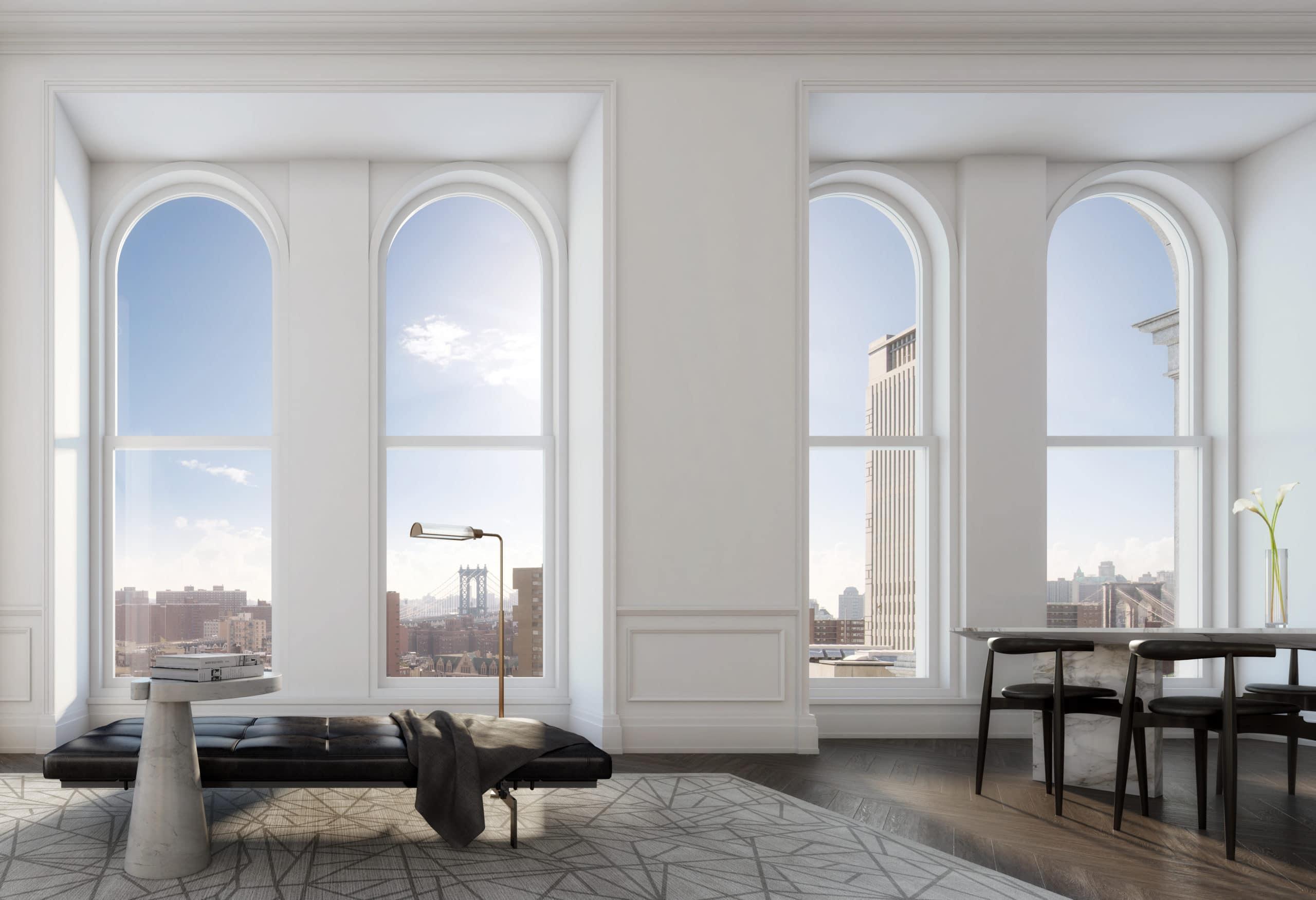 Interior residence condominium at 108 Leonard with white walls, wood flooring, and windows that overlook New York City.