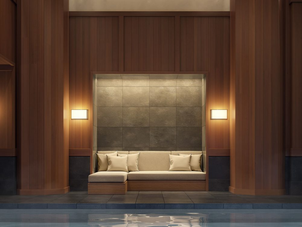 Interior view of 67 Vestry residence indoor pool in New York City. Has dark wooden pillars and a couch with pillows.