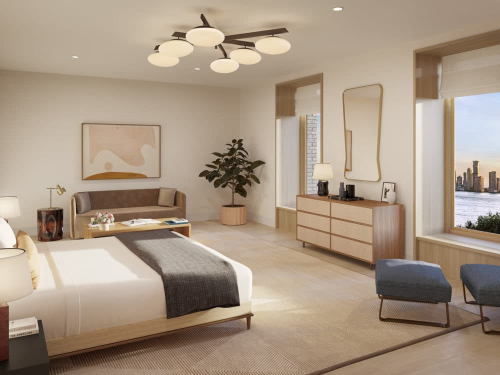 Interior view of 67 Vestry residence master bedroom with window view of New York City. Has bed, dressers and couches.