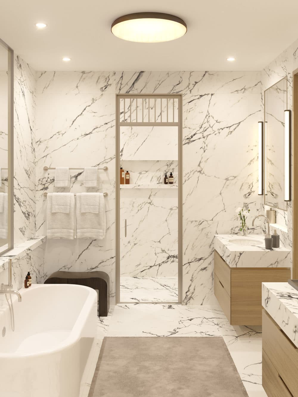 Interior view of 67 Vestry residence master bathroom in New York City. Has marble walls, counters and floors.