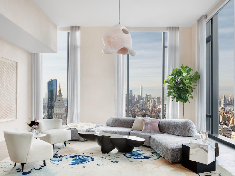 Interior view of living room in 277 Fifth Avenue condominiums with window views of NYC. Has chairs, couch, and lamp.