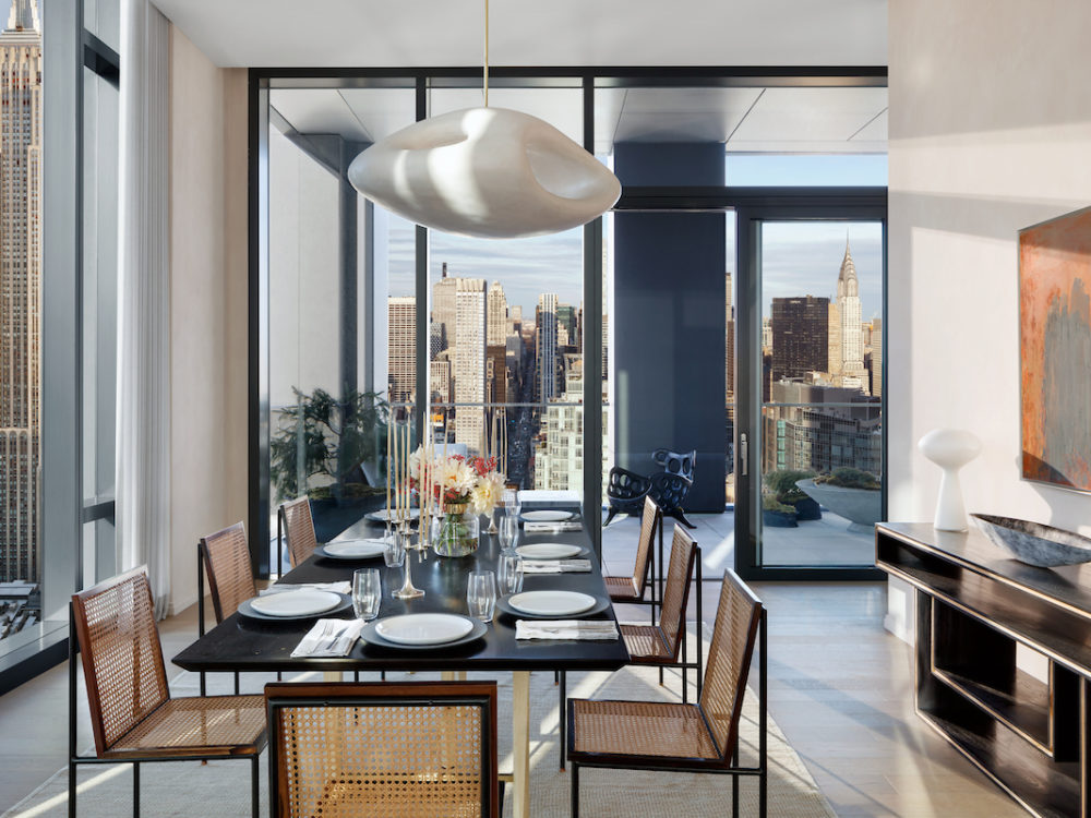 277 Fifth Avenue condo interior with corner exposure, floor-to-ceiling windows, dining room table and city views.