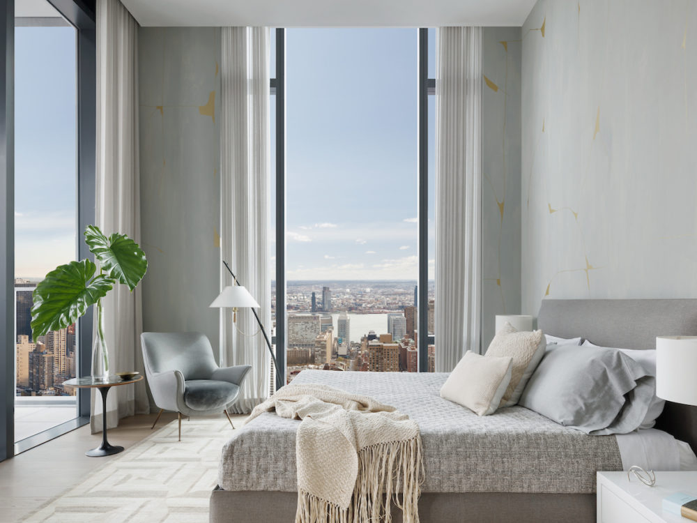 Interior view of master bedroom inside 277 Fifth Avenue condominiums with window view of NYC. Has bed facing the windows.