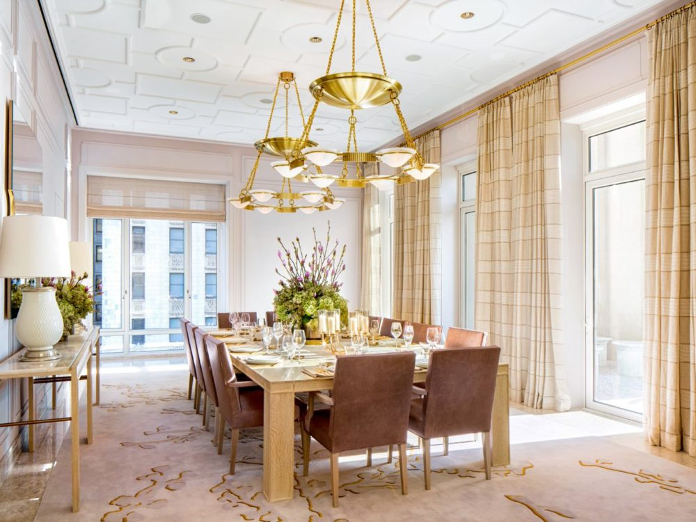Interior view of 30 Park Place residence private dining room with window view of NYC. Includes full table and chair setup.