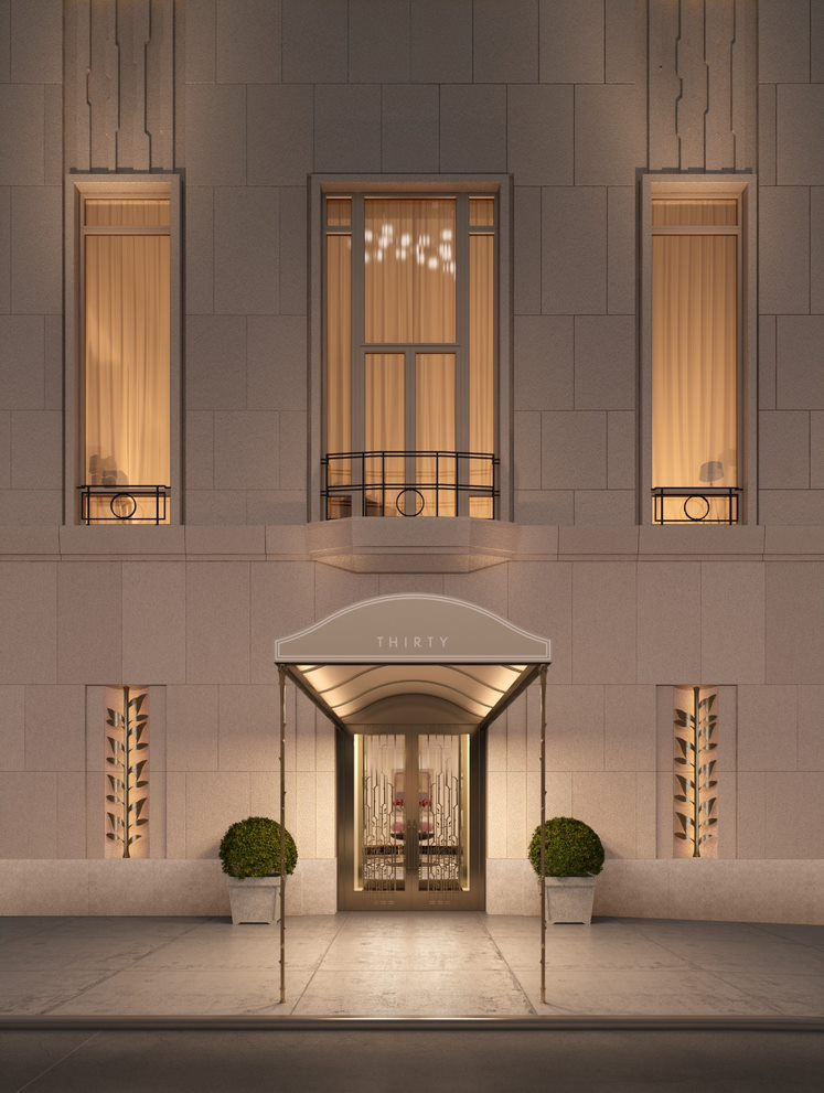 Exterior view of entrance to 30 Park Place condominiums in NYC. Includes white walls and lights leading to building.