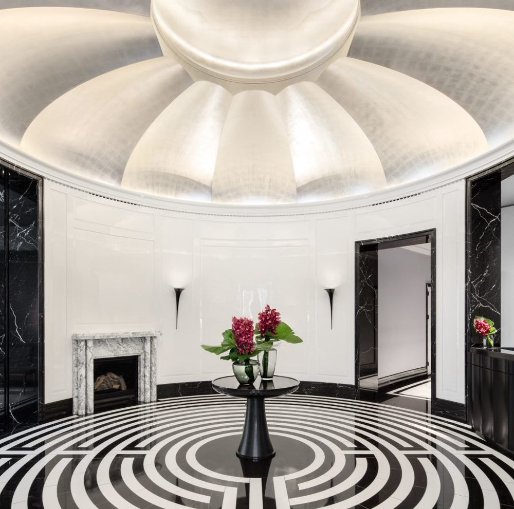 Interior view of 30 Park Place residence lobby in New York City. Includes labyrinth floor pattern and white ceilings.