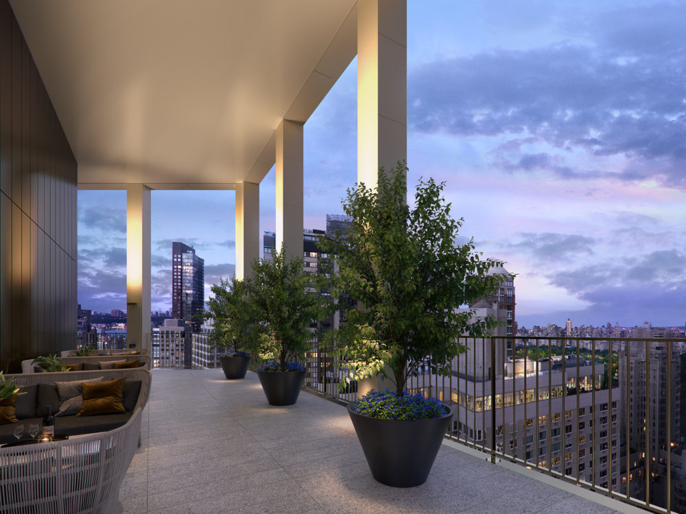 View from the Park Loggia's rooftop terrace overlooking NYC. An open air terrace with high ceilings, seating and plants.