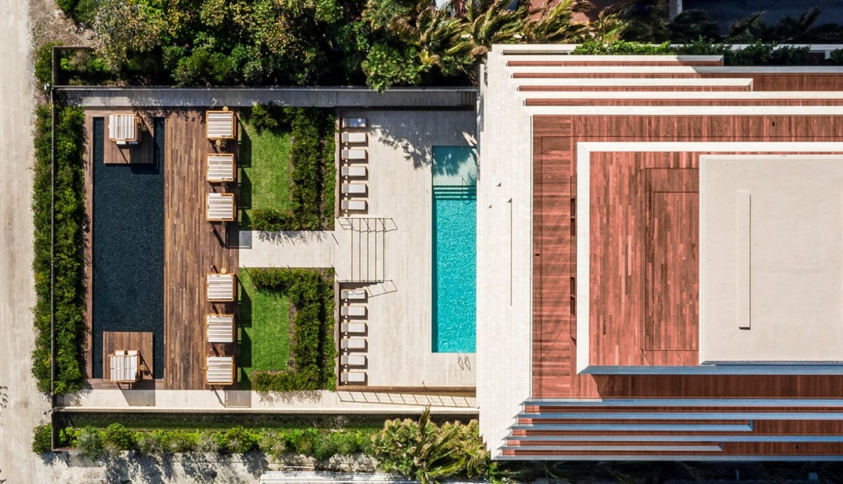 Exterior aerial view of Arte Surfside condominiums with oceanfront view. Has rooftop and front entrance pool.