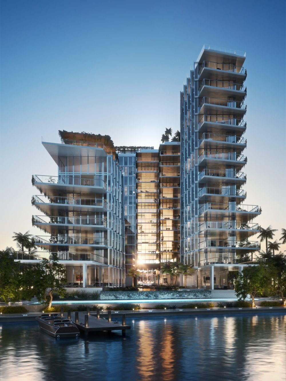 View of Monad Terrace taken from Biscayne Bay in Miami. Condo building next to the water with glass walls reflecting the sun.