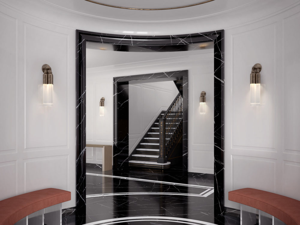 Entrance rotunda at The Belnord apartments in NYC. Circular room with benches and marble floors with view of the staircase.