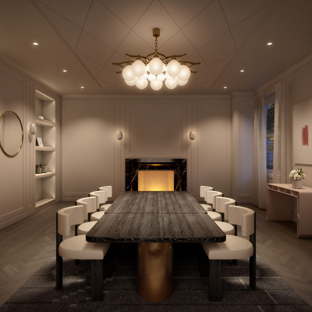 Private dining room at The Belnord in NYC. Long dining table with chandelier, a fireplace, built-in shelves and windows.
