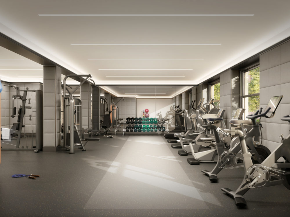 Fitness center at The Belnord apartments in New York. Open room with exercise bikes, a hanging punching bag and free weights.
