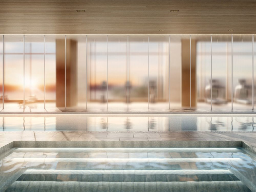 The Xi luxury condominiums in New York offer a whirlpool room with glass walls providing views while relaxing.