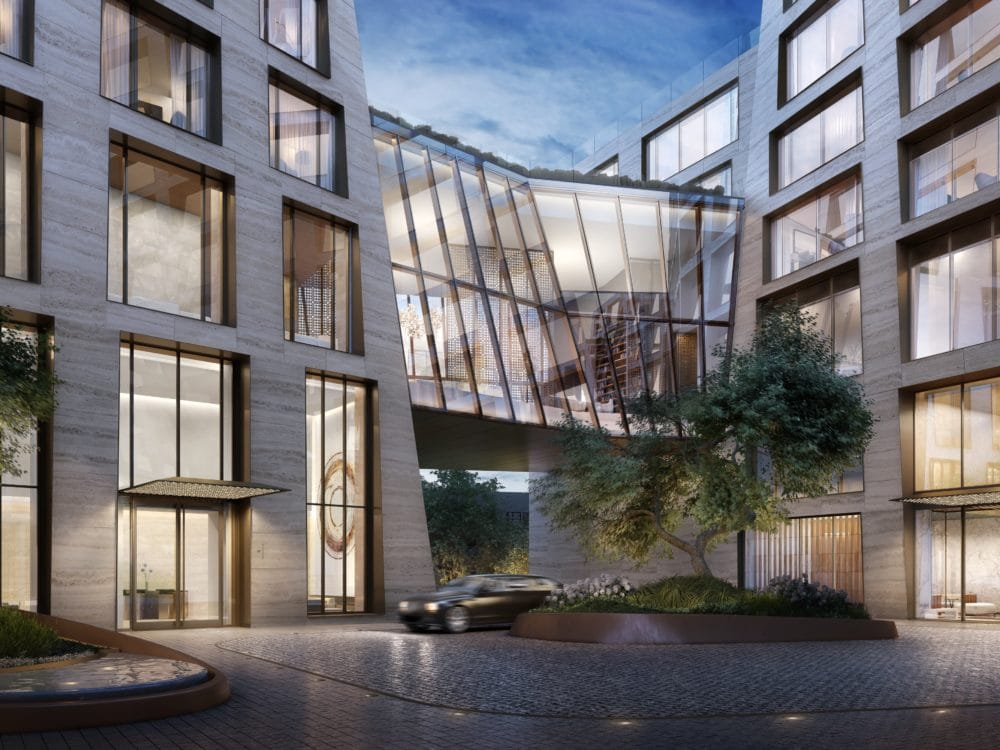 The Xi luxury condos in New York. View of exterior courtyard and driveway, with car turning around in the roundabout.