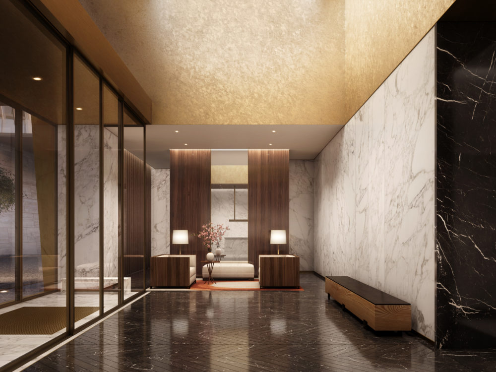 East Tower lobby of The Xi condos in NYC. The lobby has high ceilings, light and dark stone walls, and large glass doors.