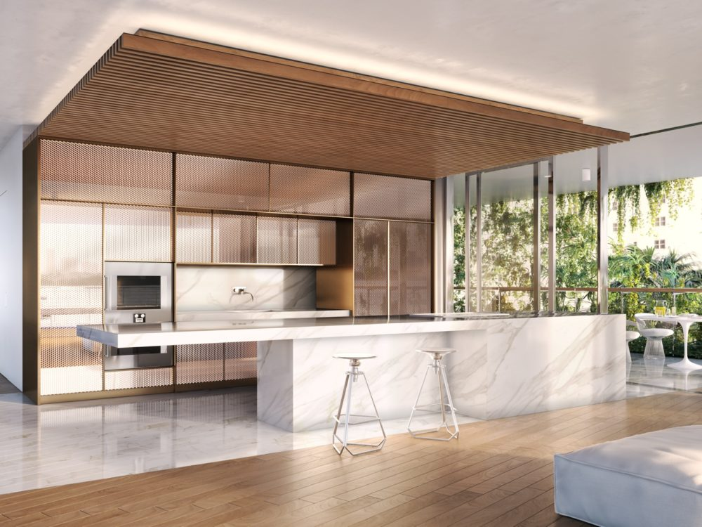 Kitchen at Monad Terrace condominiums in Miami. Open kitchen with wood overhang, stone island and views into the living room.