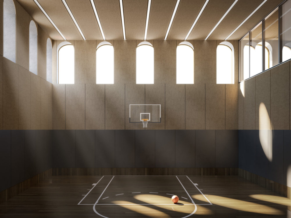 Interior of 130 William condominiums basketball court in New York City. Includes arched windows, a ball, and a hoop.
